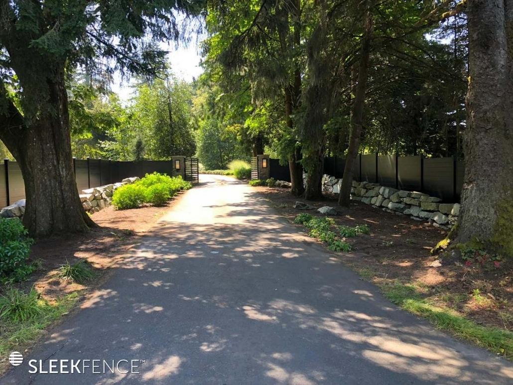 Black fence beside driveway