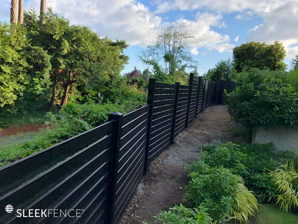 Modern horizontal slat fence on slope