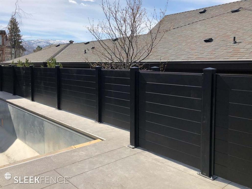 Sleek privacy fence around pool
