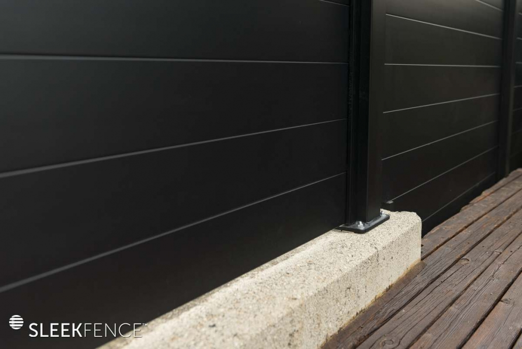 Sleek privacy fence on concrete wall